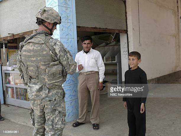 US military soldier talks to an Iraqi boy at the Rabiya Market Photo taken on May 5 2007 Photo by Kianne Sadeq/NBC NewsWire