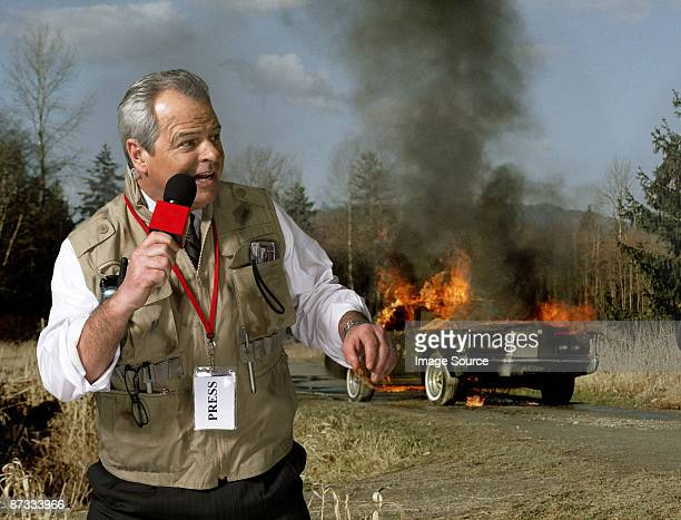 News presenter and car on fire