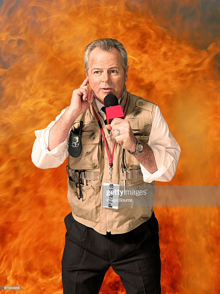 News presenter and fire : Stock Photo