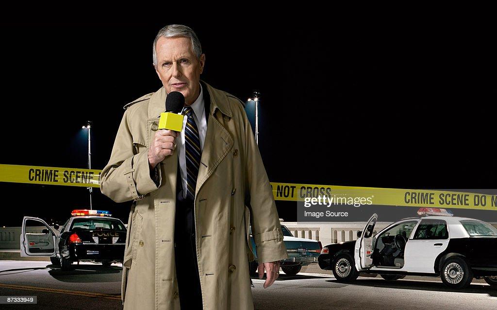 News presenter at crime scene
