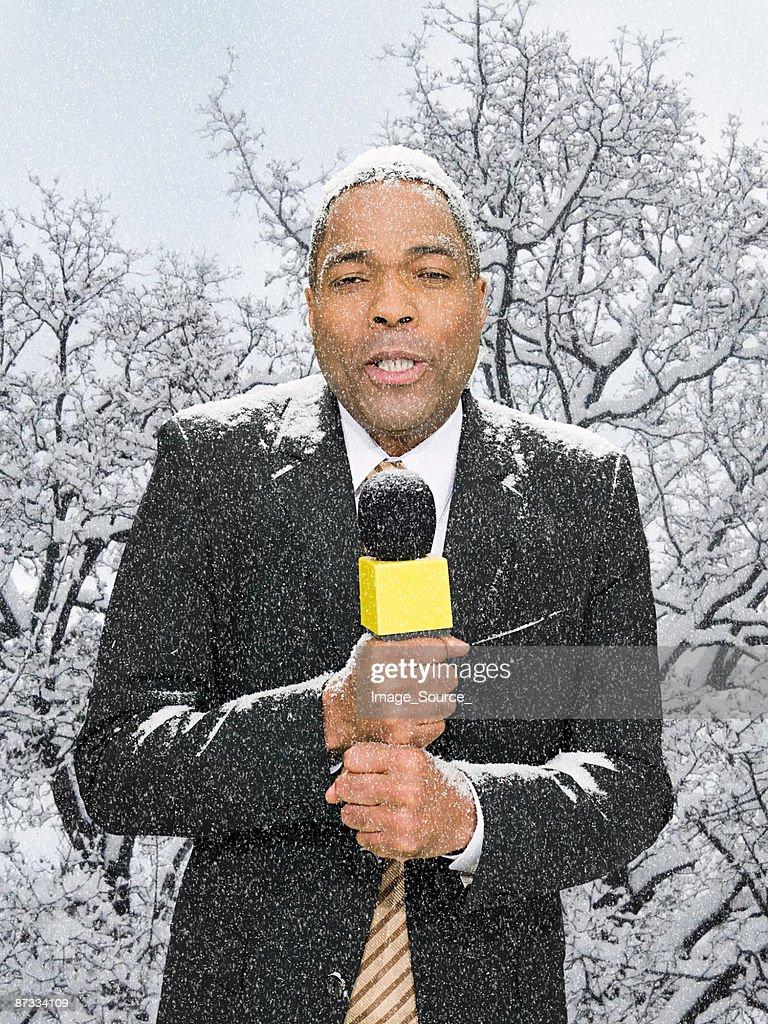 News presenter in snow : Stock Photo