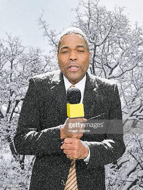 News presenter in snow