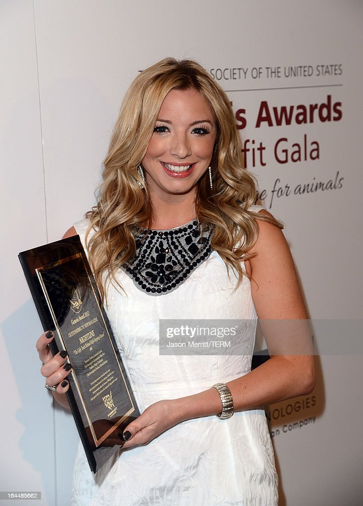 TV news producer Megan Chuchmach poses backstage with the Outstanding TV Newsmagazine award at The Humane Society of the United States 2013 Genesis Awards Benefit Gala at The Beverly Hilton Hotel on March 23, 2013 in Los Angeles, California.