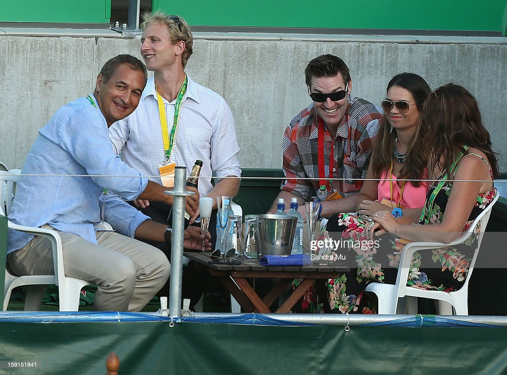 News reader Mike McRoberts, Olympic rower Hamish Bond and basketballer Dillon Boucher are seen in a corporate box during day three of the Heineken Open at ASB Tennis Centre on January 9, 2013 in Auckland, New Zealand.