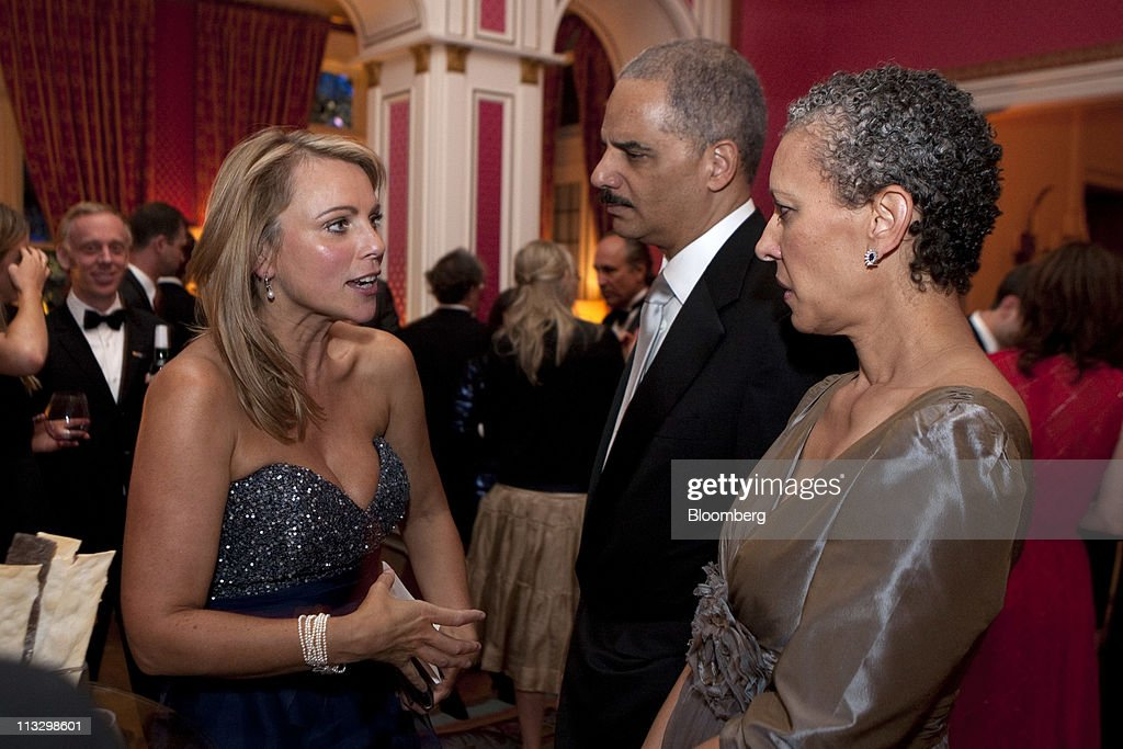 CBS News reporter <a gi-track='captionPersonalityLinkClicked' href=/galleries/search?phrase=Lara+Logan&family=editorial&specificpeople=3008086 ng-click='$event.stopPropagation()'>Lara Logan</a>, left, U.S. Attorney General <a gi-track='captionPersonalityLinkClicked' href=/galleries/search?phrase=Eric+Holder&family=editorial&specificpeople=1060367 ng-click='$event.stopPropagation()'>Eric Holder</a>, center and Holder's wife Dr. Sharon Malone attend the the Bloomberg Vanity Fair White House Correspondents' Association (WHCA) dinner afterparty in Washington, D.C., U.S., on Saturday, April 30, 2011. The dinner raises money for WHCA scholarships and honors the recipients of the organization's journalism awards. Photographer: Joshua Roberts/Bloomberg via Getty Images