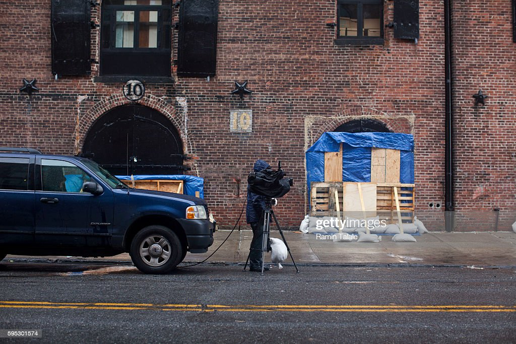 A news reporter photographs a low level area during the Hurricane Sandy in the Red Hook section of Brooklyn NY on Monday October 29 2012 Hurricane...