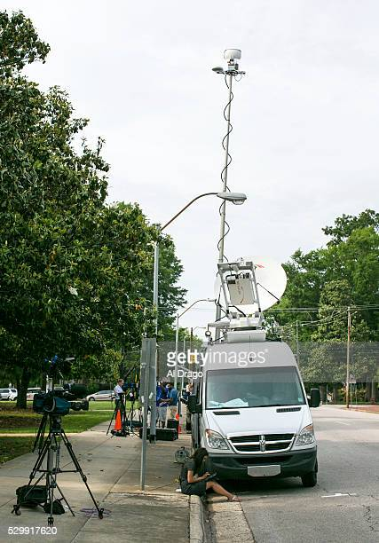 STATES MAY 9 A news reporter prepares for a live shot for the evening news outside of the Governor's Mansion in Raleigh NC on Monday May 9 2016 Gov...