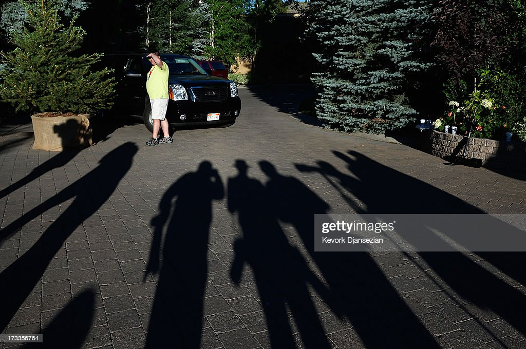 News reporters and photographers wait outside the Sun Valley Inn during the Allen & Co. annual conference as a security officer watches July 12, 2013 in Sun Valley, Idaho. The resort will host corporate leaders for the 31st annual Allen & Co. media and technology conference where some of the wealthiest and most powerful executives in media, finance, politics and tech gather for week long meetings. Past attendees included Warren Buffett, Bill Gates and Mark Zuckerberg.
