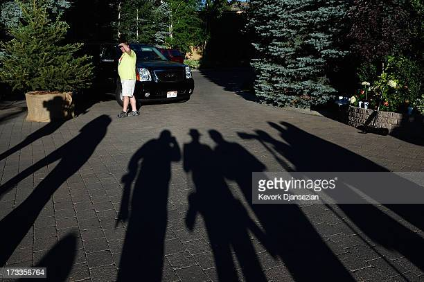 News reporters and photographers wait outside the Sun Valley Inn during the Allen Co annual conference as a security officer watches July 12 2013 in...