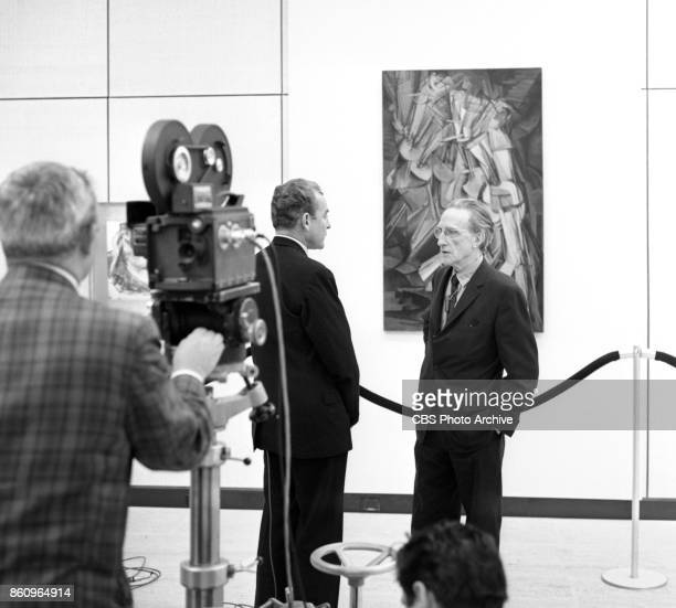 News series Eyewitness to History CBS News reporter Charles Collingwood with artist Marcel Duchamp and his painting Nude Descending a Staircase...
