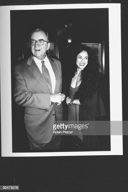 TV news show host John McLaughlin posing w actress Sonia Braga at party for the movie premiere of A League of Their Own at Tavern on the Green...