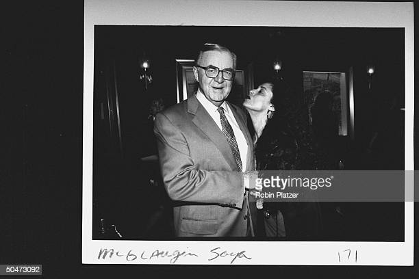 TV news show host John McLaughlin shaking hands w actress Sonia Braga who is puckered up to give him a kiss at premiere party for the movie A League...