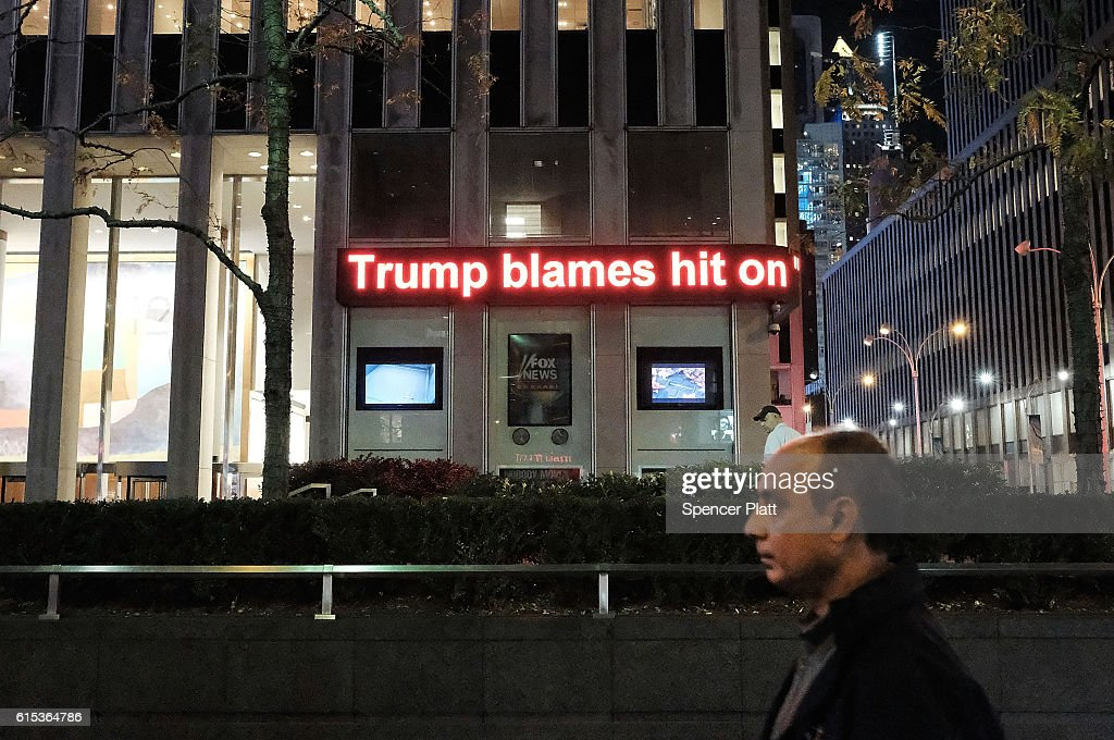 A news ticker displays the latest stories from the campaign trail on October 17, 2016 in New York City. As the nation prepares for the final debate between presidential candidates Donald Trump and Hillary Clinton, America has become transfixed on the issues surrounding the two historic candidates. America will go to the poles to pick the next president on November 8.