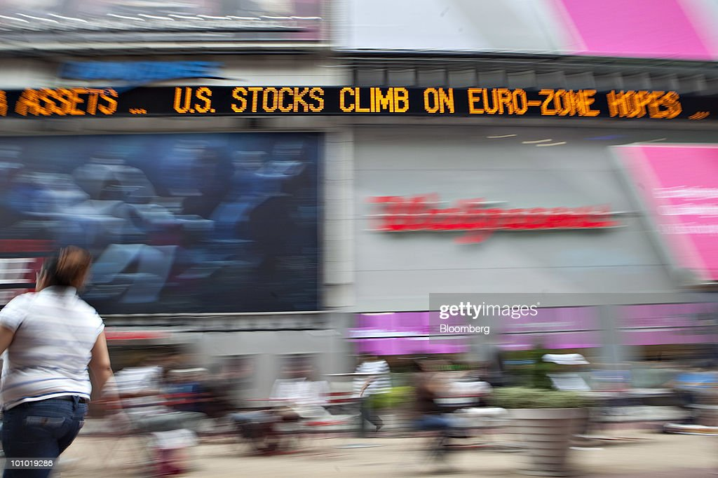 A news ticker in Times Square displays a stock market headline in New York, U.S., on Thursday, May 27, 2010. Stocks surged and the euro snapped a three-day decline against the dollar as China said it remains a long-term investor in Europe, easing concerns that the region's debt crisis will worsen. Commodities jumped and Treasuries fell. Photographer: Daniel Acker/Bloomberg via Getty Images