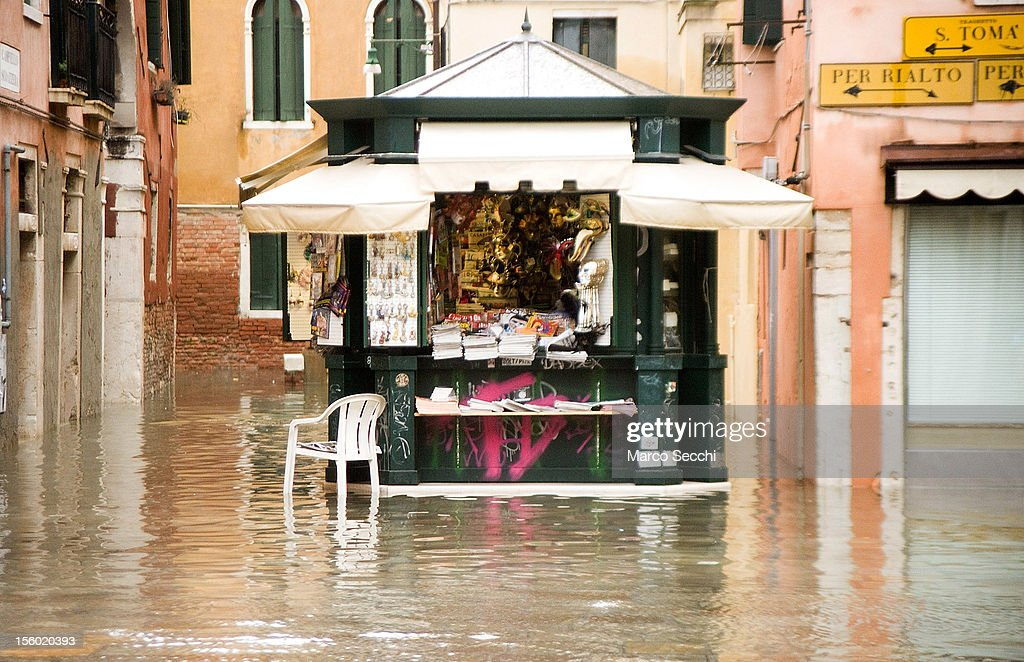 A newsagent in a flooded part of Venice during the exceptional High Water on November 11, 2012 in Venice, Italy. More than 70% of Venice has been been left flooded, after the historic town was hit by exceptionally and unexpected high tide. The sea level rose very quickly to 150 due as well to strong southerly wind and heavy rain.