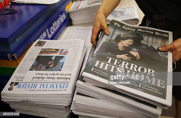 A newsagent organises the morning papers on December 16 2014 in Sydney Australia The siege in Sydney's Lindt Cafe in Martin Place is over after 16...