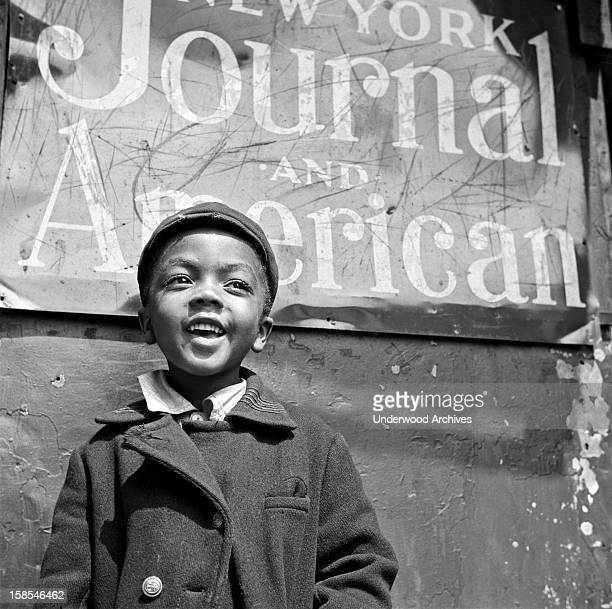A newsboy in Harlem New York New York May 1943