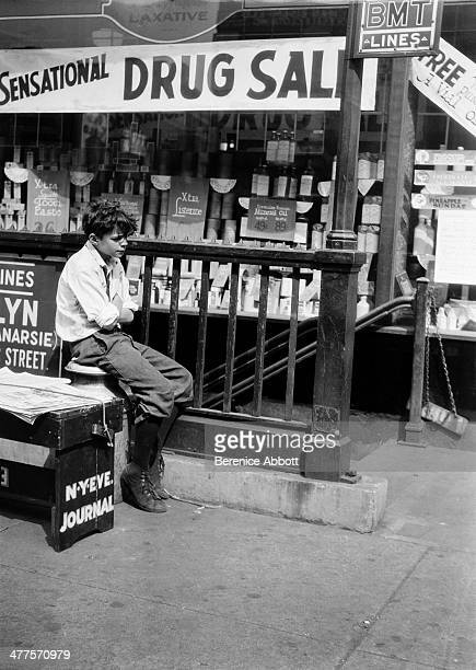 A newsboy next to BMT Subway Entrance New York City New York circa 1930