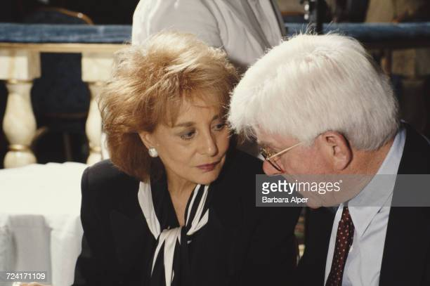 TV newscaster Barbara Walters and talk show host Phil Donahue at a party given by the Creative Coalition advocacy group October 1995