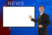 A standing tv television news, weather meteorologist, anchorman or reporter is reporting with a colorful background and a blank screen to add your image or message.