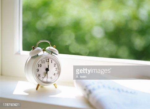 Newspaper and Alarm clock : Stock Photo