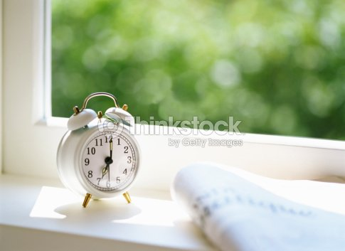 Newspaper and Alarm clock : Stock Photo