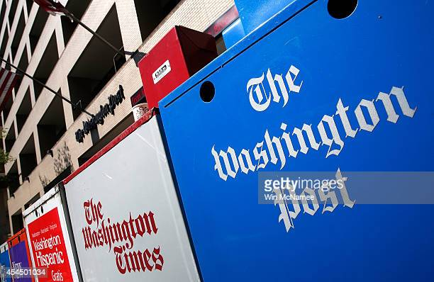 Newspaper boxes stand outside the Washington Post building September 2 2014 in Washington DC It was announced that Frederick Ryan has been named the...