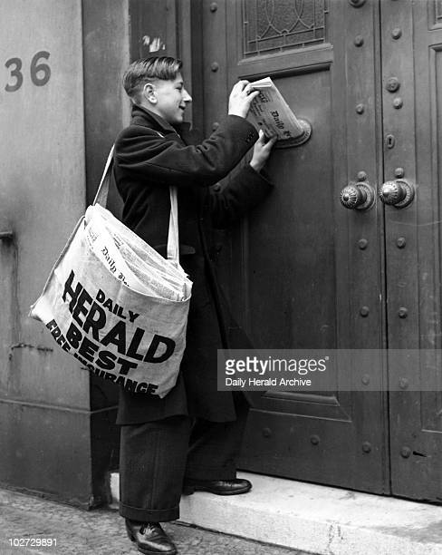 Newspaper boy delivering the 'Daily Herald' 13 December 1935 ' Paper boy delivering the 'Daily Herald newspaper Photograph by Harold Tomlin
