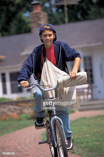 Newspaper boy riding bike