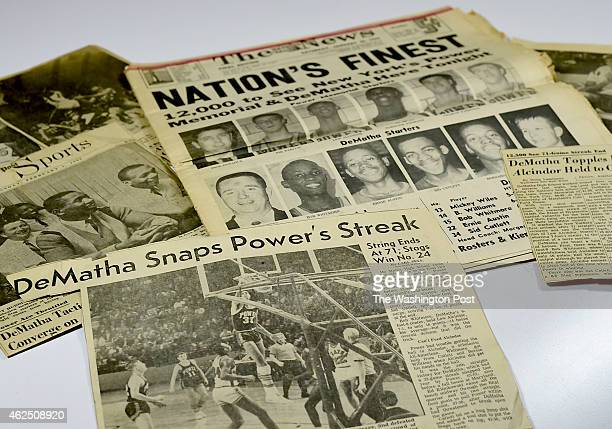 Newspaper clippings in a scrapbook created by DeMatha High School after the 1965 game in which DeMatha upset New York City's Power Memorial and...