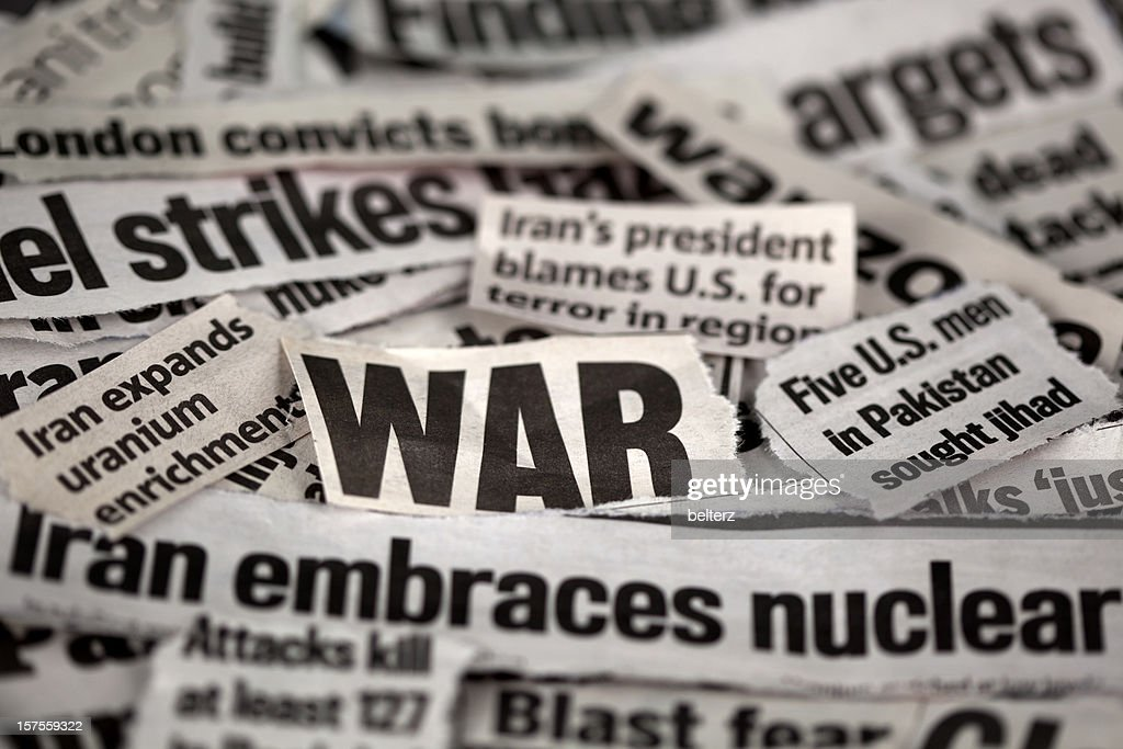 Newspaper cut outs with WAR related themes : Stock Photo