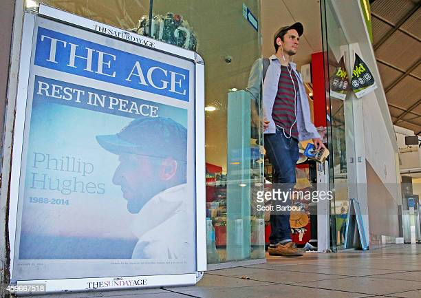 A newspaper display board with a photograph of Phillip Hughes sits on display outside of a newsagent on November 28 2014 in Melbourne Australia...