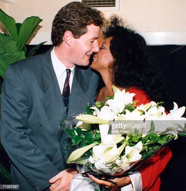 Newspaper editor Piers Morgan poses with singer Diana Ross during his time as editor of the Bizarre showbusiness column of The Sun newspapers Piers...
