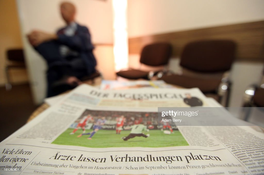 A newspaper headline about doctors breaking off talks with insurance companies is seen in a doctor's waiting room on September 5, 2012 in Berlin, Germany. Doctors in the country are demanding higher payments from health insurance companies (Krankenkassen). Over 20 doctors' associations are expected to hold a vote this week over possible strikes and temporary closings of their practices if assurances that a requested additional annual increase of 3.5 billion euros (4,390,475,550 USD) in payments are not provided. The Kassenaerztlichen Bundesvereinigung (KBV), the National Association of Statutory Health Insurance Physicians, unexpectedly broke off talks with the health insurance companies on Monday.