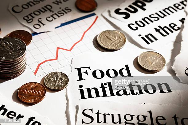 Newspaper headlines on food inflation, with coins and rising graph