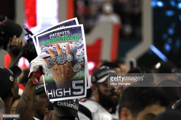 A newspaper is held after the New England Patriots defeated the Atlanta Falcons to win super bowl 51 at NRG Stadium on February 5 2017 in Houston...