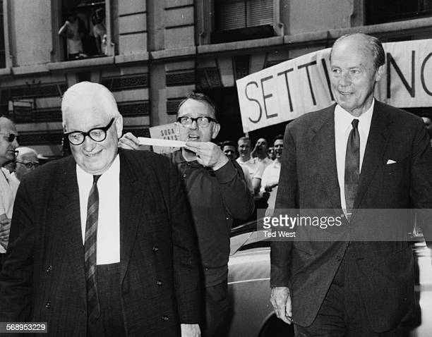 Newspaper magnate Lord Thomson of Fleet and Lord Rothermere proprietor of Associated Newspapers and the Daily Mail are greeted by a striker from the...