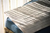 Newspaper on Chair, Close Up