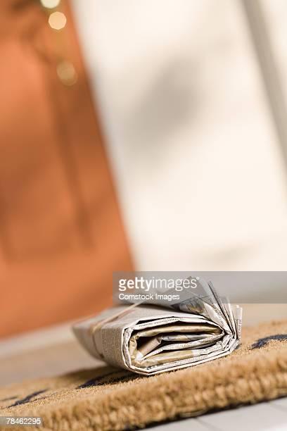 Newspaper on porch