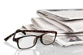 Closeup of Newspapers with Eyeglasses