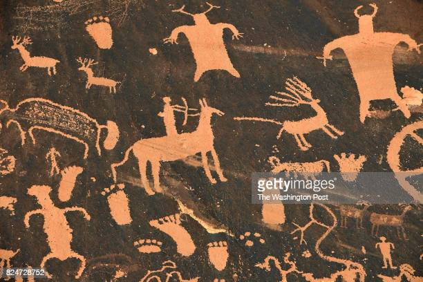 Newspaper Rock is a petroglyph panel etched in sandstone that records approximately 2000 years of early human activity June 10 2017 near Monticello UT