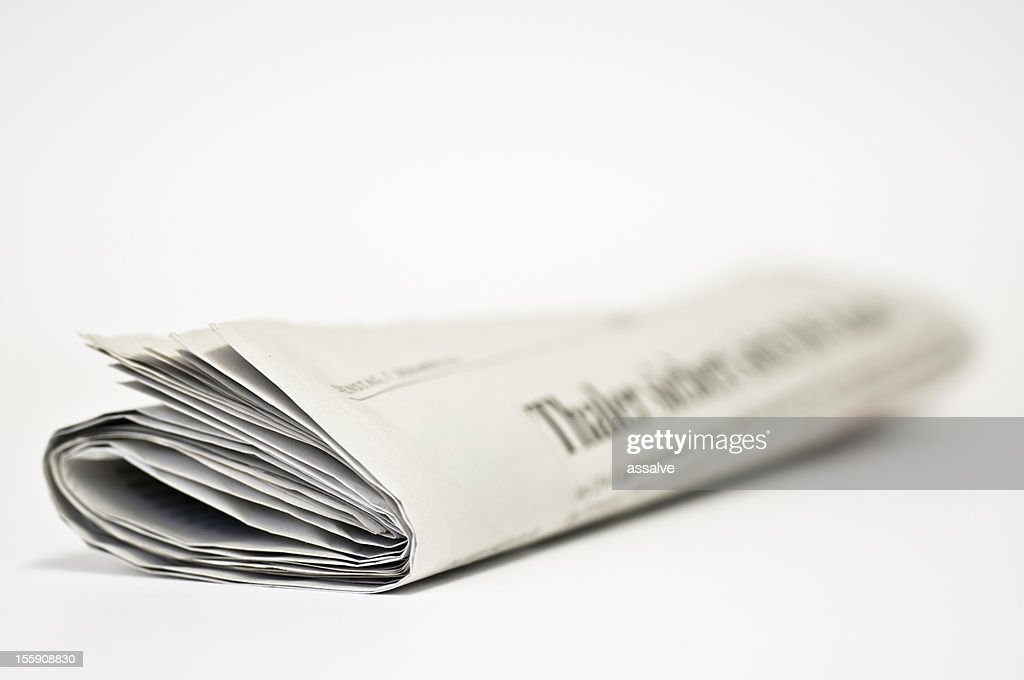 newspaper rolled side front view : Stock Photo