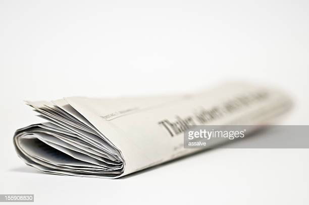 newspaper rolled side front view