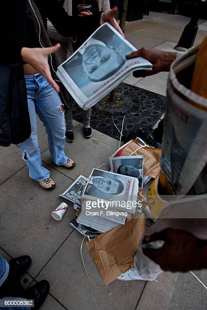 Newspaper seller Albert Elvis hands out copies of the November edition of the Chicago Sun Times as fast as he can in Chicago Never in his career has...