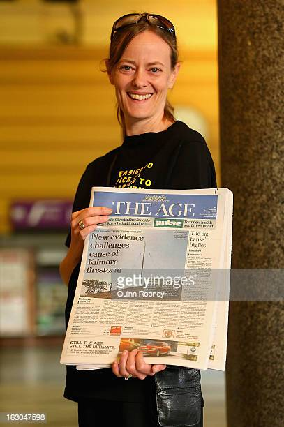 A newspaper seller displays The Age's first compact edition newspaper at Flinders Street Station on March 4 2013 in Melbourne Australia The Sydney...