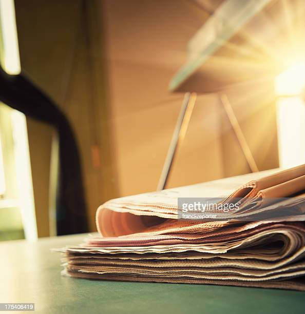 Newspaper stack close up