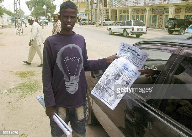 Newspaper street vendor Hassan Ahmed approaches a car 26 September 2005 on a street of Hargeisa Somaliland 'I've finished all my newspapers because...