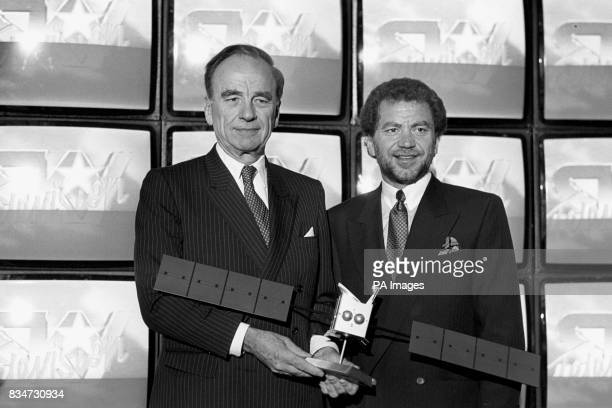 Newspaper tycoon Rupert Murdoch and millionaire businessman Alan Sugar hold a model of the Astra Satellite at a London press conference where Mr...