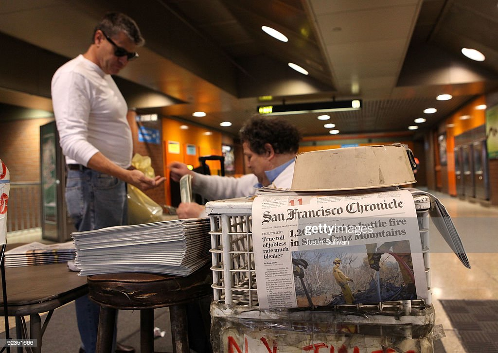 Newspaper vendor Rick Gaub (R) helps a customer with change at his stand in an underground rail station October 26, 2009 in San Francisco, California. A report by the Audit Bureau of Circulations reveals that the average daily circulation of U.S. newspapers fell 10.6 percent in the six month period between April-September compared to one year ago. The San Francisco Chronicle had the largest decline with a drop of 25.8 percent to 251,782. The Wall Street Journal surpassed USA Today as the number one selling paper in the U.S. after USA Today had its circulation drop more than 17 percent to 1.90 million.
