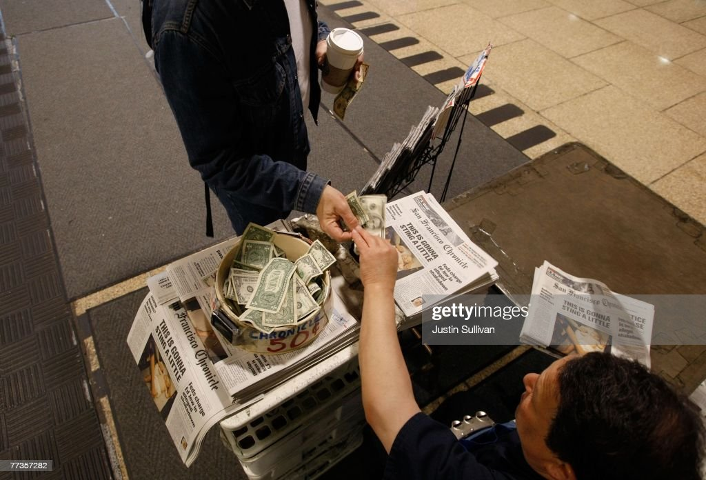 Newspaper vendor Rick Gaub sells a copy of the San Francisco Chronicle at his newsstand in the San Francisco Municipal Railway station September 21, 2007 in San Francisco, California. Newspaper sales in the U.S. continue to slide as people turn to the internet and television for their news. The Chronicle saw its circulation plunge more than 15 percent in 2006 to 398,000 during the week which has hurt Rick Gaub's newsstand business. Unable to sell as many papers as he used to, Gaub is looking for a new way to earn money after selling papers for 42 years.